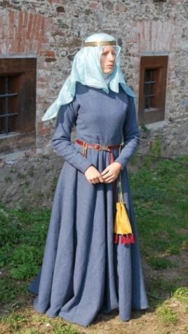 German Lady 1250         dressed in linen shirt, silk cotte and woolen upper dress was inspired by statues in Magdeburg cathedral (ca 1250). Picture on the left is showing quitte simple version of head dress