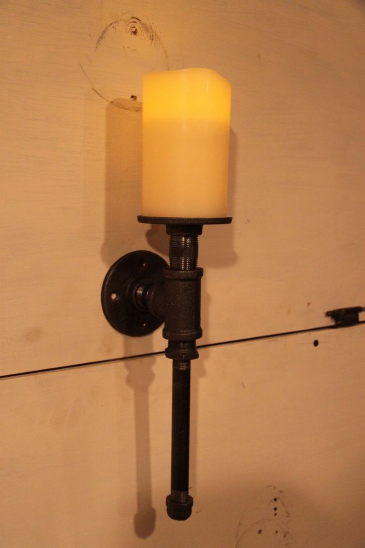 Industrial pipe candle holder sconce. $40.00, via Etsy.