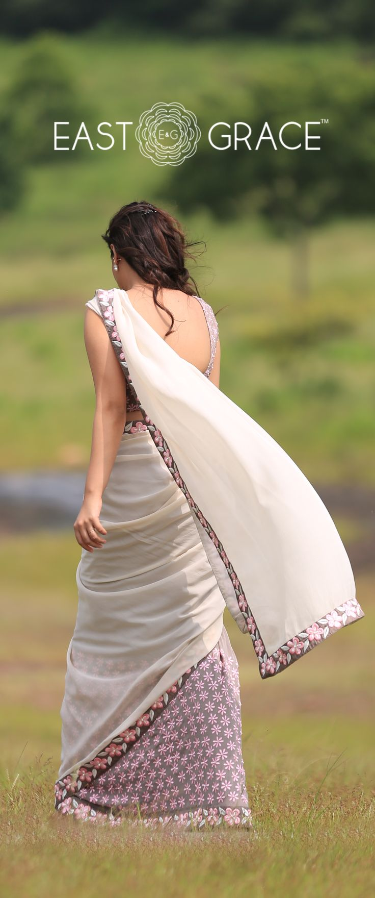 Featuring a misty gray pure georgette saree from EAST & GRACE with beautiful neon pink Frangipani flowers embroidered on the trims and along the pleats of the saree. Pleats are flow-dyed in deeper gray. Send us a message via www.facebook.com/.... Visit www.eastandgrace.com. Saree on Sale! Price: RS.9,000.