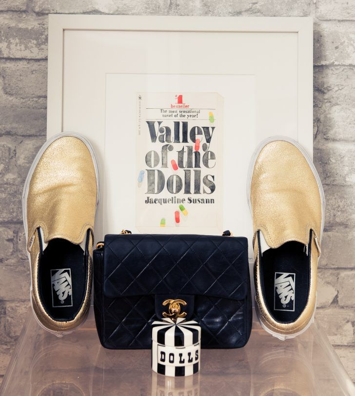 "Inside Interior Decorator Fiona Byrne's Closet: Gold Slip On Vans Slippers, Black Structured Chanel Purse, ""Valley of the Dolls"" Poster 