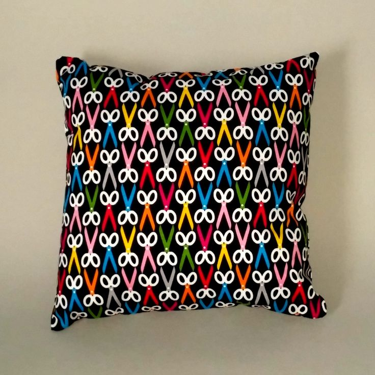 Our 'Cut Blooms' cushion combines black and white Evening Blooms fabric by Riley Blake with multi-coloured Snippy Fabric by Sew Yummy.