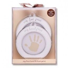 The perfect gift for new parents - or for a Baby's Baptism, this Hand and Foot Print Keepsake enables you to make a print of the Baby's hand and foot and frame each in a circular silver frame. Years go by so fast and soon that baby boy will be six feet tall or your baby girl a young woman - so treasure the memory of when they were tiny!