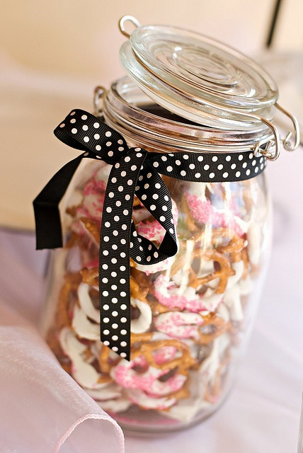 dip preztels in white or brown chocolate and add some sprinkles. Put them in a jar for a neat presentation.