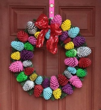 Colorful Pinecone Wreath. My sister made this! She spray painted pine cones and then hot glued them to a plain green wreath!  I love mine she made me!!! Colorful Pinecone Wreath