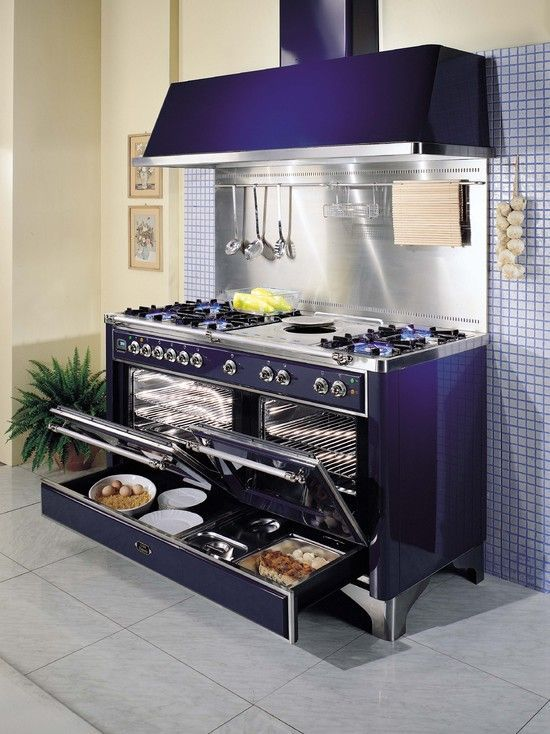 ILVE Range with 7 burners plus simmer plate, double ovens, vent hood, utensil rack, and optional warming drawer