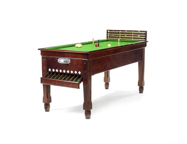 A mahogany bar billiards table