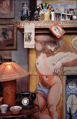 Charleston Farmhouse, home of the Bloomsbury group of artists, fireplace painted by Duncan Grant.