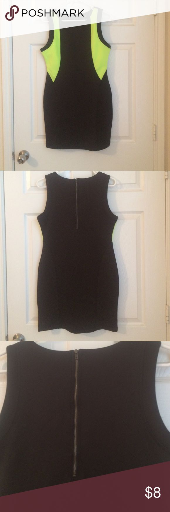 Scuba fabric fitted dress Dress is mini. Scuba like material. Had exposed zipper in back and stretches pretty well. Dress is black and neon yellow/green. Dress is new w/out tags Forever 21 Dresses Mini