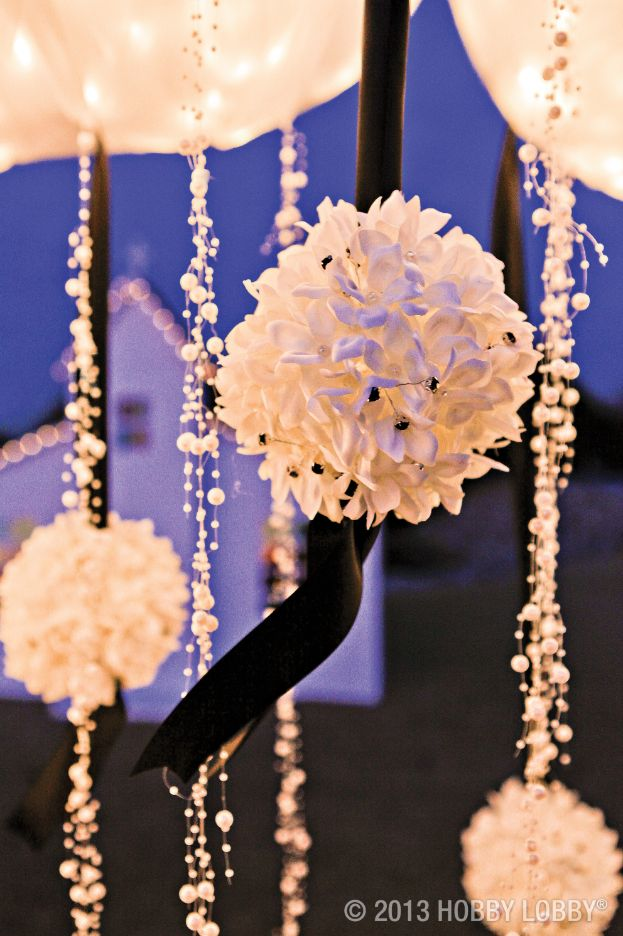 from hobby lobby we altered these dainty kissing balls to complement our romantic black and white dcor each