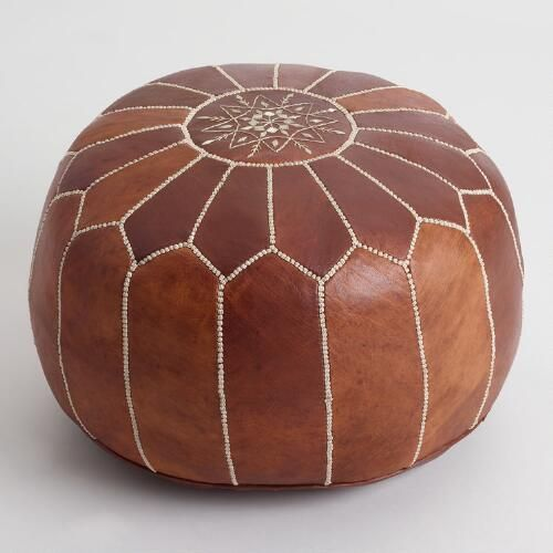 Caramel Leather Moroccan Pouf | World Market  Doubles as a rocking chair ottoman and extra seating.