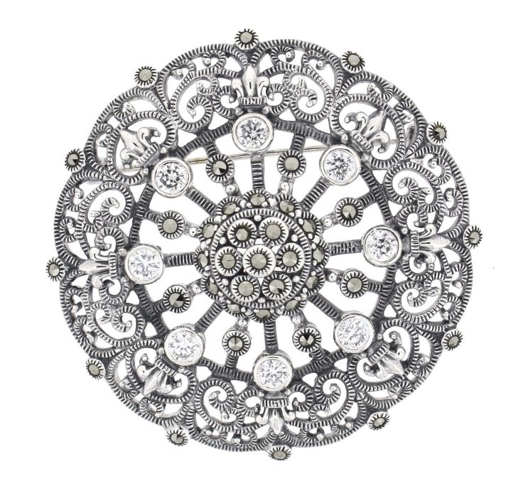 Cubic Zirconia Marcasite Brooch/Pendant €195.00 This Stunning Brooch can also be worn as a Pendant Beautifully presented & packaged Clear Cubic Zirconia Stones set with Marcasite in Sterling Silver