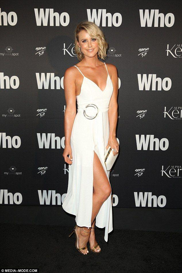 Flattering look:TV presenter Olivia Phyland flashed her toned thighs in a floaty white gown, that featured a thigh-high slit