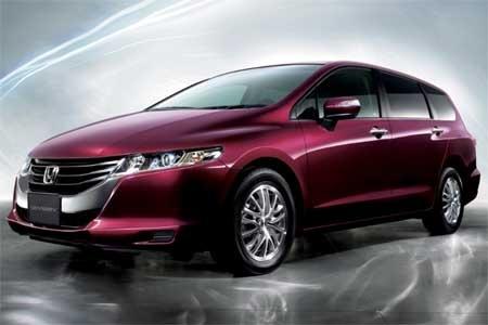 honda minivan in hot metallic wine.  Gimme, gimme....I love this color