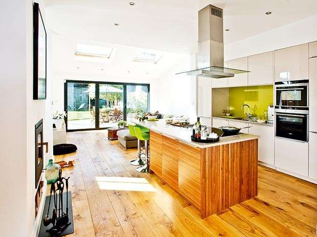 Working with a narrow space: Instead of moving to a bigger house, the owners of this detached Victorian home created the extra space they needed by replacing an old conservatory with an extension, turning the previously narrow kitchen into a sociable open-plan space.