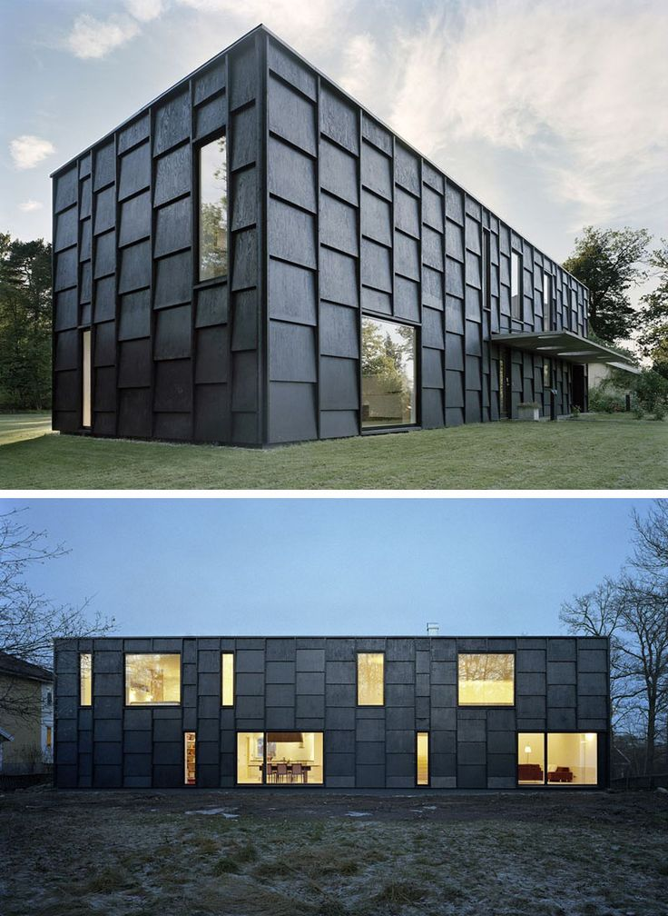 House Exterior Colors – 14 Modern Black Houses From Around The World | Large black wood panels cover the exterior of this thin home and create a shingle-like appearance.