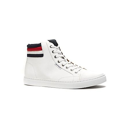 Tommy Hilfiger men's shoe. The classic high top sneaker gets a revamp with our signature red, white and blue at the heel. This pair looks even better off the court<br>· High top silhouette in fabric.<br>· Cushioned insole, rubber outsole.<br>· 1'' heel.<br>· Imported.<br><br>