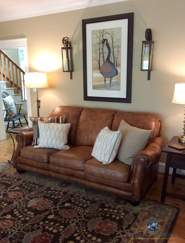 Lenox Tan Benjamin Moore in farmhouse warm living room with brown leather couch and area rug. Kylie M Interiors E-design and Colour Consulting
