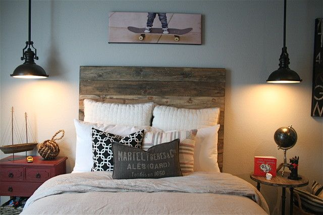 Industrial bedroom with recycled timber bedhead and vintage style lighting