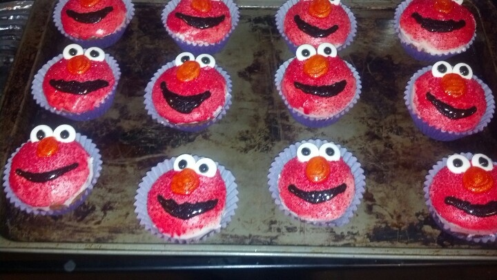 Elmo cupcakes: bake cupcakes in a well greased cupcake tin, without using liners. When completely cool the cupcakes will come out very easy. Dip cupcakes in warm frosting, when cool repeat. Its ok if frosting runs down the side. Sprinkle red sugar/sprinkles on before second coat of frosting dries. Spray cupcakes with several layers of red edible non toxic sugar spray. Add more sprinkles if you want! Then, add the candy eyes, orange sparkle gel nose, and black sparkle gel mouth. Lastly set…