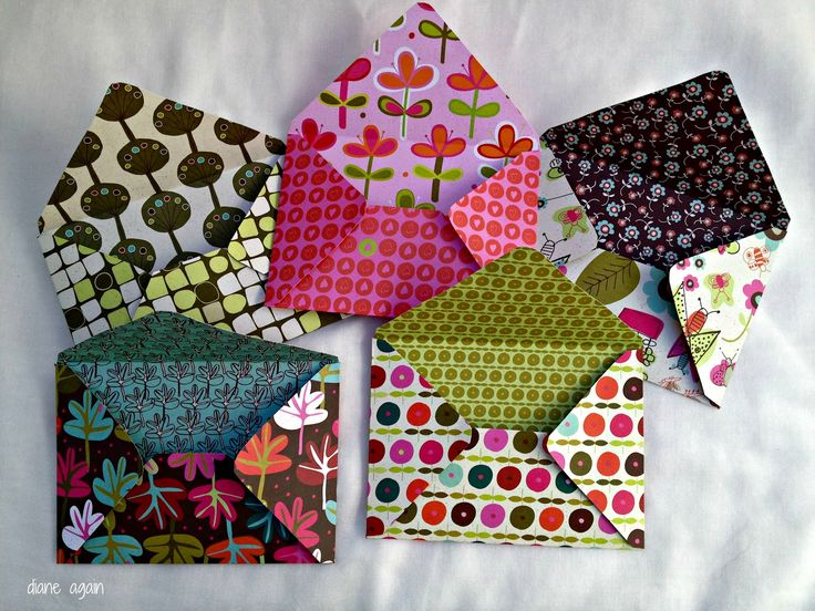 Envelopes from double sided paper. Non need to glue-- just fold shut when ready and tack closed with a sticker or gluedot.