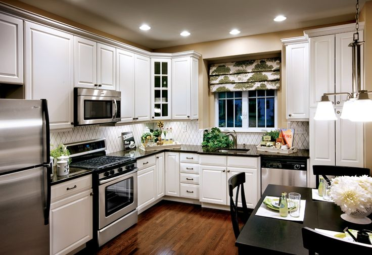 i love the use of black countertops with white cabinets and stainless steel appliances and then. Black Bedroom Furniture Sets. Home Design Ideas