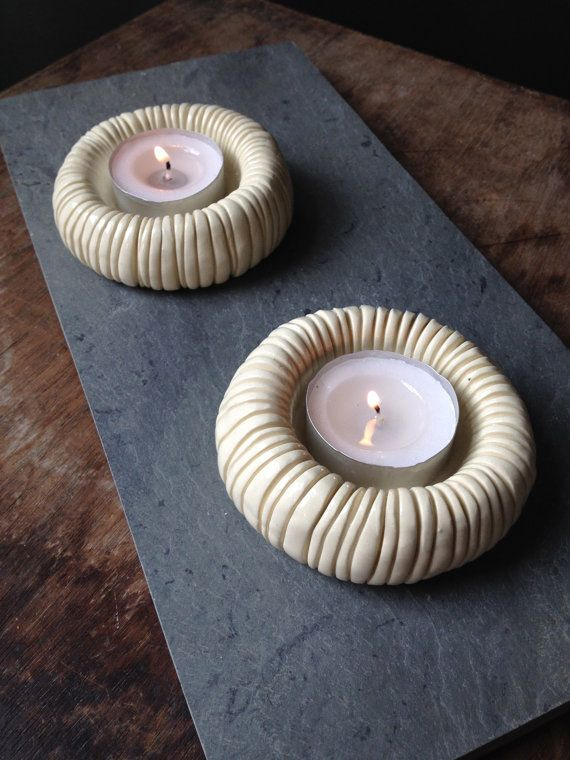 Inspired by tide pools, fossils, and microscopic organisms, this set of 2 hand-sculpted ceramic tea light candle holders will create a tactile,