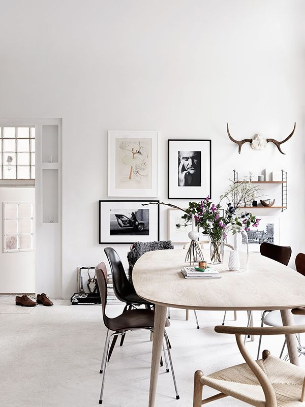 Love this dining room - light with dark, mismatched chairs and the gallery wall