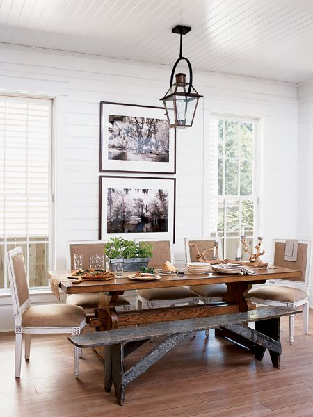 Square-back dining chairs combined with an antique bench around the dining table feel less formal than a complete set of matching chairs. (Photo: Robbie Caponetto, Roger Foley)