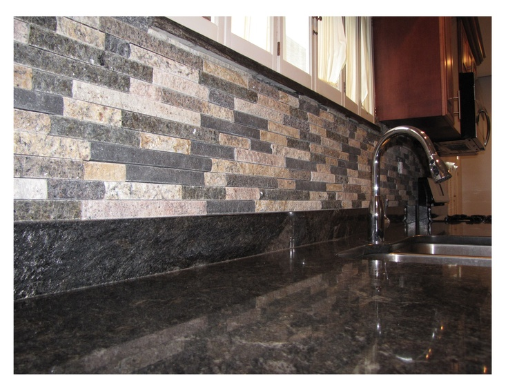 Mixed Color Thin Stone Veneer As A Backsplash In A Kitchen