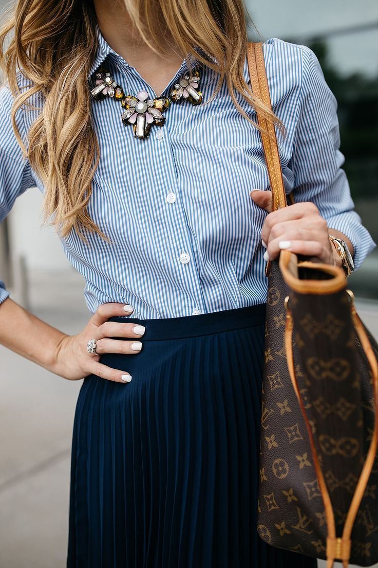 business casual outfit idea, incorporating trends at work, how to be stylish at the office, pleated midi skirt outfit, navy and blush pink outfit, business professional outfit idea, spring work wear outfit, ann taylor perfect shirt with baublebar statemen