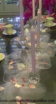 bridal shower decorations @Michael Dussert Grace I like the idea of candles and tulle on the table like this... maybe with some flower petals and rhinestones for color/bling...What do you think?