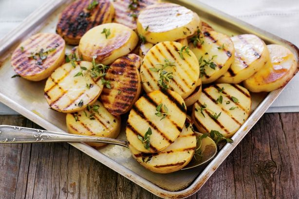 Tender potatoes earn their stripes on the grill - perfumed with fresh thyme, they're a winner with barbecued steak.