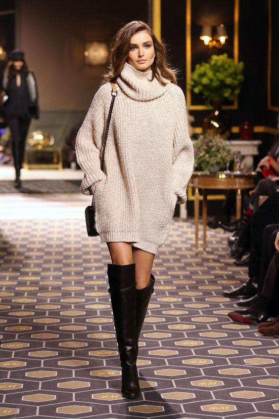 Oversize sweater + over-the-knee boots.