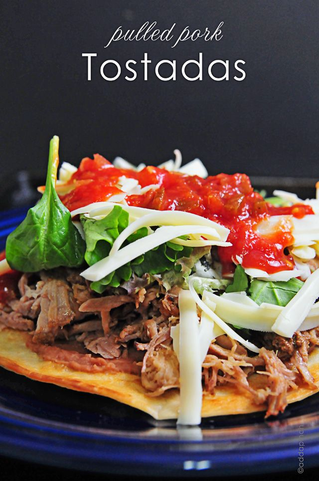 Canola oil,  6 corn or flour tortillas,  salt,  1 (15-oz) can refried beans,  4 cups pulled pork from pork roast,  2 cups salad greens,  8-12 oz grated Monterrey Jack or cheddar cheese,  1 cup salsa,  ½ cup sour cream,  1 avocado.