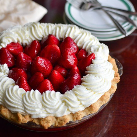 ... to the brim with fresh strawberries and crowned with whipped cream