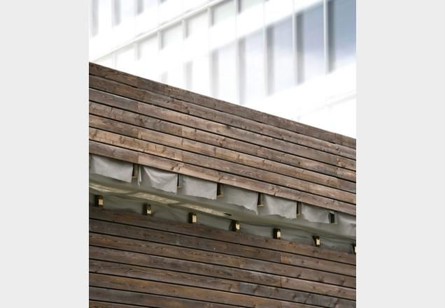 Charred timber at DSDHA's Parkside kiosk near London's City Hall links the area's past and present | Technical | Building Design