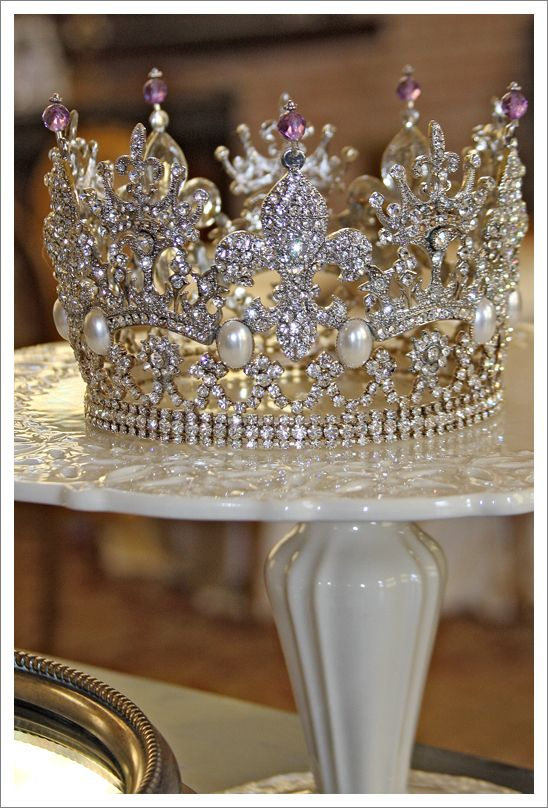 Winner, Winner!!!  I finally located the source for this crown, which has constantly been misidentified as either the Poltimore tiara from Princess Margaret, or more recently, the Amethyst tiara formerly belonging to Empress Josephine! It is a lovely table decoration found on a blog belonging to two lovely ladies who have a passion for all things sparkly -http://whathappensnext.typepad.com/.a/6a00e54ee297f8883401156fa36912970c-pi.