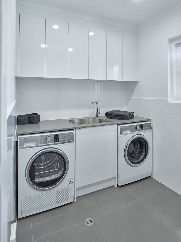 Simple yet versatile Laundry design. #brilliantsa #laundry #renovation #washinmachine #dryer #sink #trough #sinkmixer #overhangcupboards