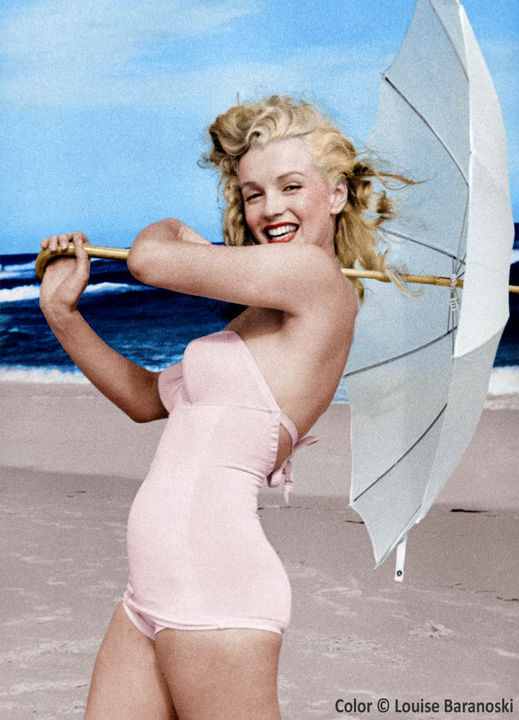 Marilyn Monroe with umbrella, b&w photo taken by André de Dienes, colorized by Louise Baranoski.