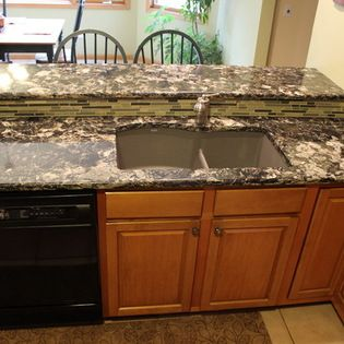 Brown Quartz Countertop With Beige Tile Backsplash Broadview Heights Oh In This Kitchen We