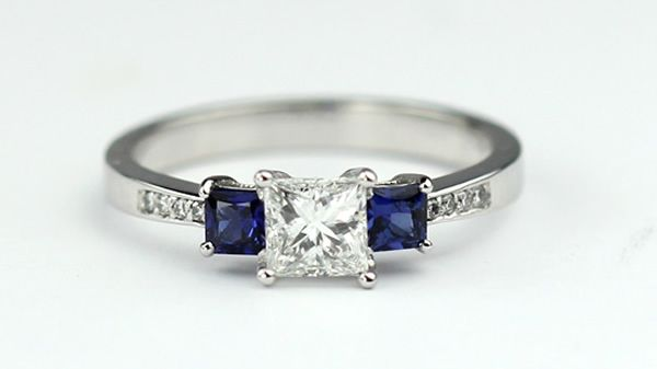 Ever since I saw the episode of Friends where Chandler buys Monica's engagement ring, I've wanted the one he got for her. The sapphires are so unique and pretty. I like this one with the square stones better, though.