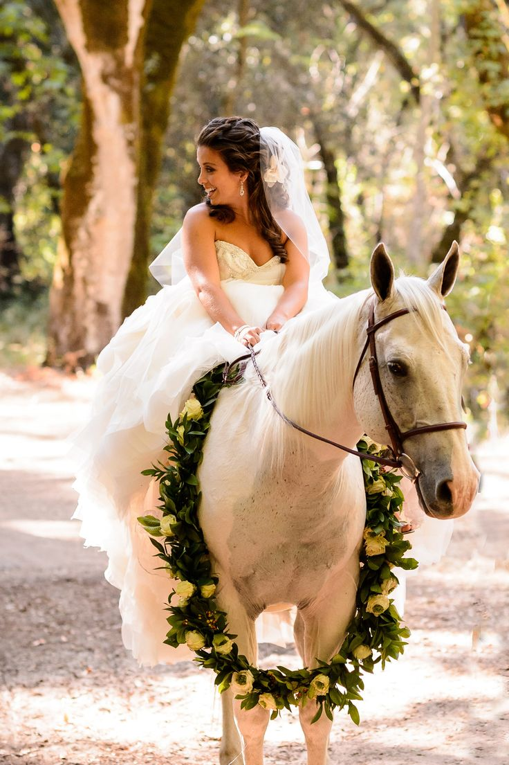 Whimsical Wedding Idea -- Equestrian Bride Makes Entrance on a Horse -- Read More: http://www.StyleMePretty.com/california-weddings/2014/04/12/facebook-advertising-vp-weds-with-rustic-barn-affair/ Photography: ChrismanStudios.com