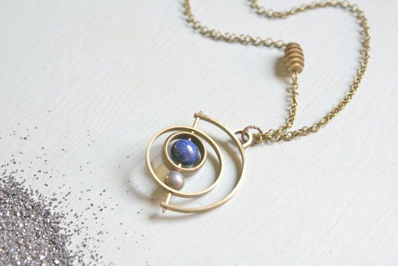the Satellite Gyroscope necklace by foxtailboutique on Etsy
