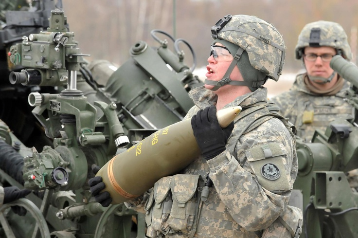 U.S. Army Soldiers assigned to Bulldog Battery, Field Artillery Squadron, 2nd Cavalry Regiment (2CR) load a M777A2 howitzer during 2CR's Maneuver Rehearsal Exercise (MRE) at Grafenwoehr Training Area, Germany on Feb. 13. Photo by Visual Information Specialist Gertrud Zach. Source: https://www.facebook.com/photo.php?fbid=10151344834948558=a.81109118557.82903.44053938557=1