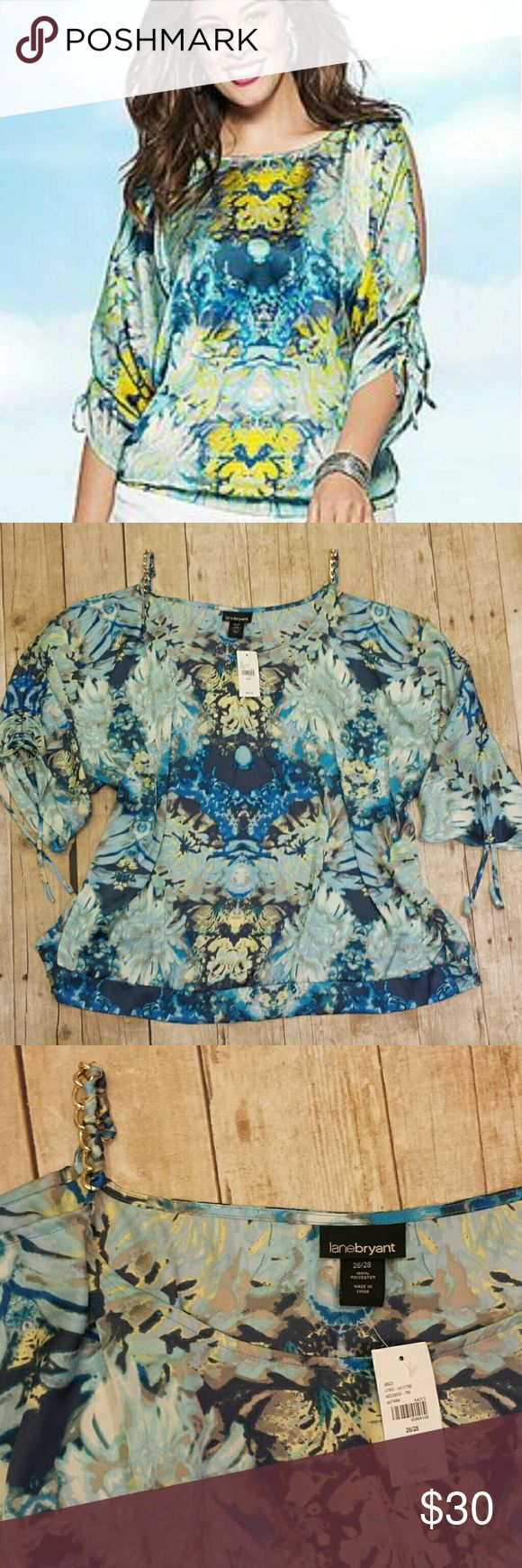 """Lane Bryant NWT Chain Cold Shoulder Top NEW WITH TAGS Lane Bryant cold shoulder Top with gold chain strap detailing. Sleeves have optional strings to bunch up or wear long.  Beautiful floral print with a watercolor vibe. Elastic band on the rear provides great coverage. 100% polyester. Size 26/28.  Retail $49.95.  Measurements  Pit to Pit 31"""" Top of chain shoulder to bottom hem 29"""" Lane Bryant Tops Blouses"""
