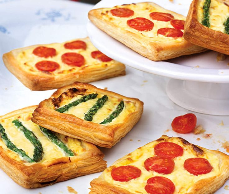 Pastry tarts topped with cherry tomatoes and asparagus