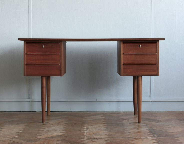 A circa 1970 Danish Teak Knee hole writing desk, having two banks of three short drawers raised on turned and tapering supports.Dimensions (cm, approx)W: 120D: 58H: 72