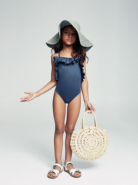 blue ruffled swimsuit and floppy hat // This little one is beach ready!