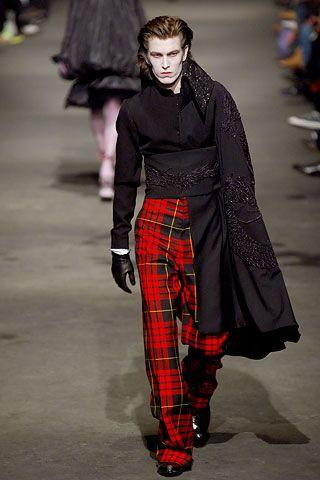 Plaid punk pants and a shoulder cape. LOVE IT