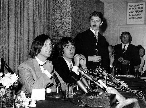 John Lennon and Paul McCartney of the Beatles announce their business venture, Apple Corps, Ltd., at a news conference in New York City on May 14, 1968